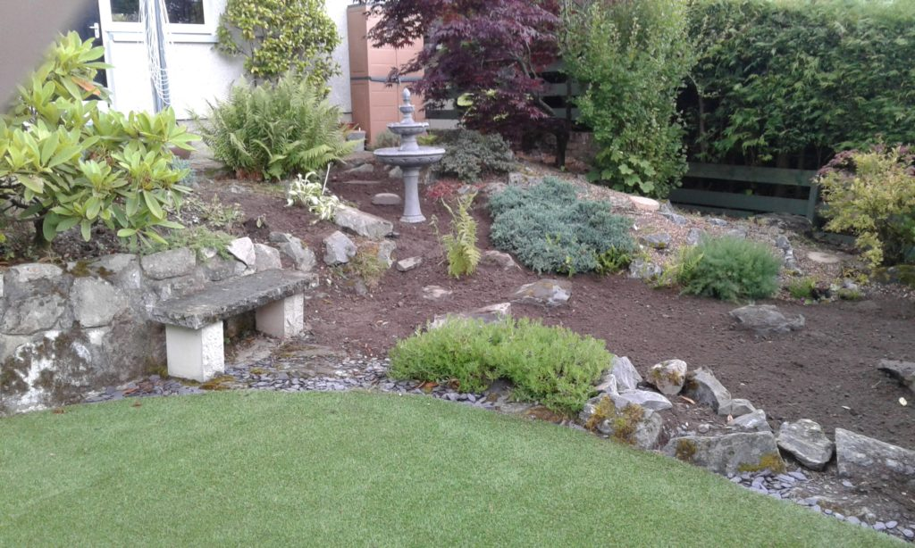 Garden featuring the water-fountain and new lawn combined.